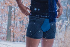 someone wearing Pyramid Seven in the snow. Just the hips and upper legs are shown