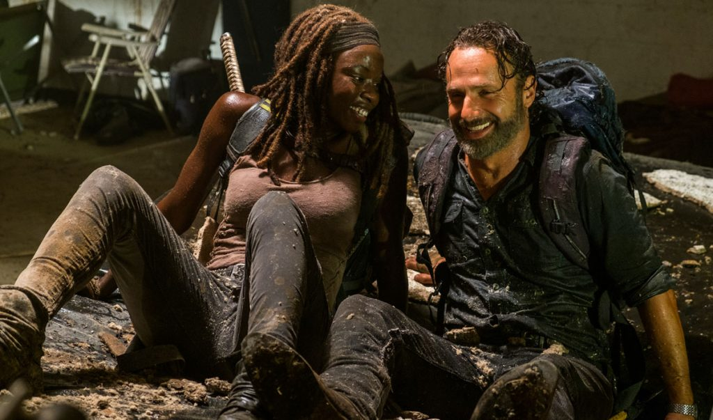 Rick and Michonne from Walking Dead sitting next to each other